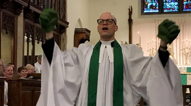 The Rev. D. Dixon Kinser wearing Incredible Hulk hands